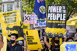 "© Licensed to London News Pictures. 17/08/2019. LONDON, UK.  Demonstrators in Parliament Square take part in a rally to show solidarity with the people of Hong Kong.  Similar ""Global Solidarity with Hong Kong"" rallies are taking place worldwide as protests in the former British colony enter their tenth week demanding democratic reforms and a halt to police brutality.  Photo credit: Stephen Chung/LNP"