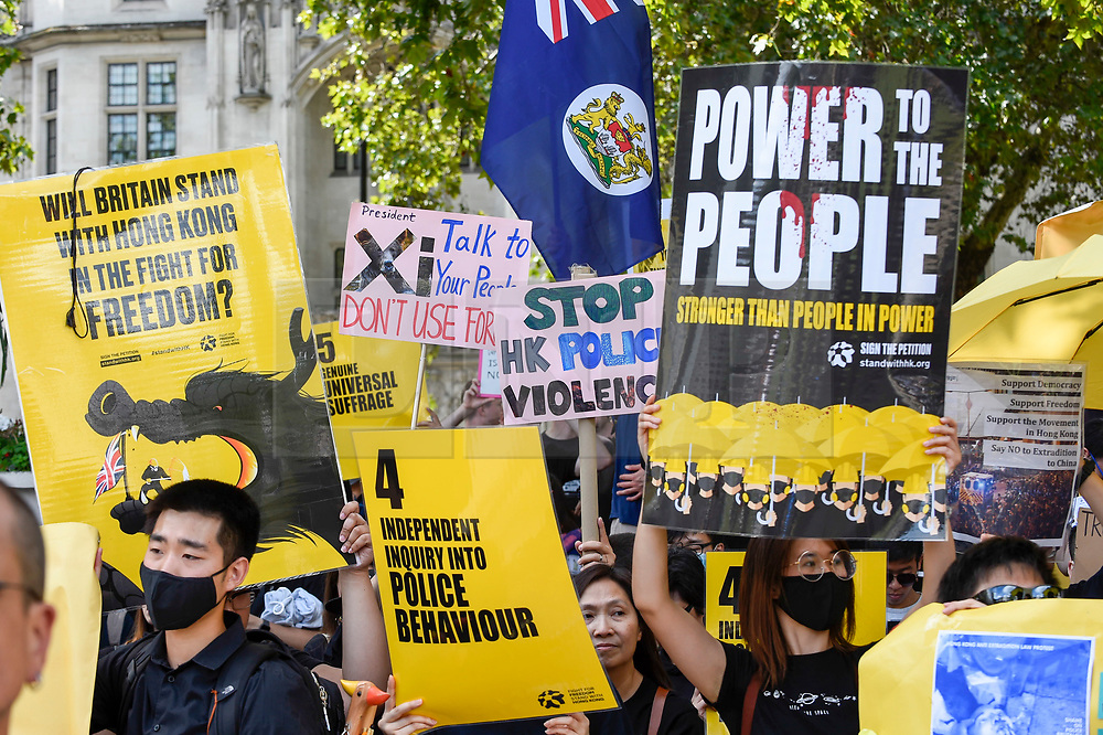 """© Licensed to London News Pictures. 17/08/2019. LONDON, UK.  Demonstrators in Parliament Square take part in a rally to show solidarity with the people of Hong Kong.  Similar """"Global Solidarity with Hong Kong"""" rallies are taking place worldwide as protests in the former British colony enter their tenth week demanding democratic reforms and a halt to police brutality.  Photo credit: Stephen Chung/LNP"""