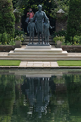 © Licensed to London News Pictures. 02/07/2021. London, UK. Members of the public view the statue of the late Princess Diana in the new landscaped Sunken Garden of Kensington Gardens. Photo credit: London News Pictures.