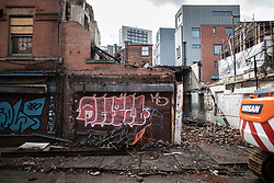 © Licensed to London News Pictures . 06/10/2018. Manchester , UK . Part-demolished building on the corner of Thomas Street and John Street , reported to have become dangerous following heavy rains after years of neglect . Campaigners say that the architectural heritage of the Northern Quarter of Manchester City Centre is under threat from developers and Manchester City Council planning policy . Photo credit : Joel Goodman/LNP
