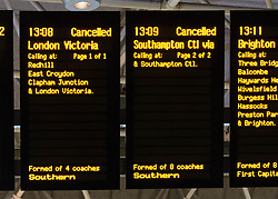 © Licensed to London News Pictures. 06/01/2014. London, UK. Signs at Gatwick Airport rail station showing disruption to services caused by the adverse weather conditions. Photo credit : Richard Isaac/LNP