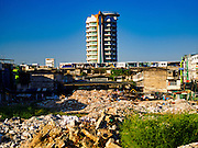 24 NOVEMBER 2015 - BANGKOK, THAILAND:  A high end condominium building towers over what is left of Bang Chak Market. The Bang Chak Market serves the community around Sois 91-97 on Sukhumvit Road in the Bangkok suburbs. About half of the market has been torn down. Bangkok city authorities put up notices in late November that the market would be closed by January 1, 2016 and redevelopment would start shortly after that. Market vendors said condominiums are being built on the land.        PHOTO BY JACK KURTZ