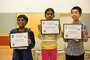 Rishik Gandhasri, left, first place, Nandana Kurup, center, second place, and Yixuan Qiao, right, third place, pose for a photo during the fourth through sixth grade segment of the 2016 Milpitas Youth Spelling Bee at the Milpitas Senior Center in Milpitas, California, on January 22, 2016. (Stan Olszewski/SOSKIphoto)