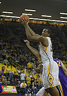 December 07 2010: Iowa Hawkeyes forward Jarryd Cole (50) pulls down a rebound during the first half of their NCAA basketball game at Carver-Hawkeye Arena in Iowa City, Iowa on December 7, 2010. Iowa defeated Northern Iowa 51-39.