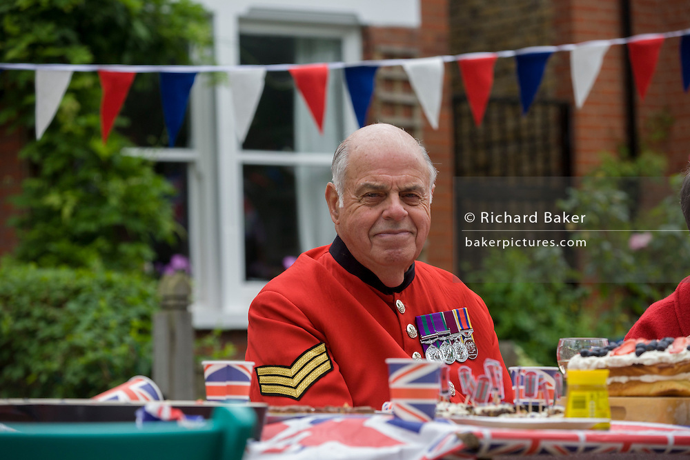 Chelsea Pensioner Sergeant at a neighbourhood street party in Dulwich, south London celebrating the Diamond Jubilee of Queen Elizabeth. A few months before the Olympics come to London, a multi-cultural UK is gearing up for a weekend and summer of pomp and patriotic fervour as their monarch celebrates 60 years on the throne and across Britain, flags and Union Jack bunting adorn towns and villages.
