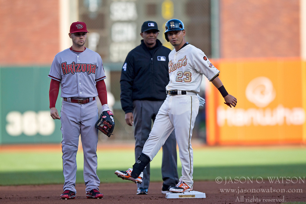 SAN FRANCISCO, CA - APRIL 18:  Nori Aoki #23 of the San Francisco Giants stands on second base after hitting a double against the Arizona Diamondbacks during the first inning at AT&T Park on April 18, 2015 in San Francisco, California.  The San Francisco Giants defeated the Arizona Diamondbacks 4-1. (Photo by Jason O. Watson/Getty Images) *** Local Caption *** Nori Aoki