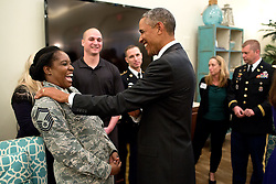 President Barack Obama speaks with military personnel and their families during a military spouse appreciation reception at the Harbor Bay Community Center in Tampa, Fla., Sept. 16, 2014. (Official White House Photo by Pete Souza)<br /> <br /> This official White House photograph is being made available only for publication by news organizations and/or for personal use printing by the subject(s) of the photograph. The photograph may not be manipulated in any way and may not be used in commercial or political materials, advertisements, emails, products, promotions that in any way suggests approval or endorsement of the President, the First Family, or the White House.