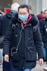 © Licensed to London News Pictures. 09/03/2020. Oxford, UK. A woman wears a face mask in central Oxford as the COVID-19 coronavirus continues to spread across the United Kingdom. Photo credit: Peter Manning/LNP