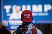 """DULUTH, MN – SEPTEMBER 9: A supporter watches  Donald Trump, Jr. during a """"Make America Great Again"""" rally in Duluth, Minnesota on Wednesday, Sept. 9, 2020."""