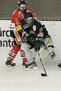 08.03.2011, Dielsdorf, Eishockey 2. Liga, Illnau - Chur, Mario Parpan gegen Roman Hardmeier (r)  (Thomas Oswald/hockeypics)