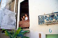 On the streets favelas in Rio de Janeiro.<br /> Two young girls at home in Complexo do Alemao, Rio de Janeiro, 2006