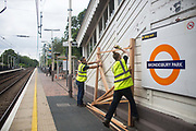 Stephen, Liam, Danica and Simon from Groundworks install trellis structures at Brondesbury Park Station as part of the build of the stations energy garden 17th June 2016, London,United Kingdom. The  Energy Gardens is a pan-London community garden project where reclaimed land alongside over ground train stations and track are cultivated by local community groups. Up 50 gardens are projected with the rail network being the connection grid. The project is a collaboration between Repowering London, Groundwork, local community groups, station managers working for Transport For London and Network Rail.