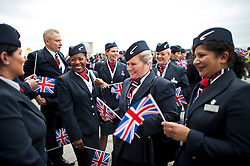 © London News Pictures. 04/07/2013 . London, UK.  British Airways staff carrying union flags as they wait for the new British Airways AIRBUS A380 superjumbo to arrive at Heathrow Airport. It was the first time British Airlines have taken delivery of the new plane, making British Airways the first European airline to operate both the 787 and A380. Photo credit : Ben Cawthra/LNP