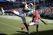 Los Angeles Chargers wide receiver Keenan Allen (13) leaps in the air and catches a fourth quarter pass subsequently ruled no catch while covered by Kansas City Chiefs defensive back Orlando Scandrick (22) during the 2018 regular season week 1 NFL football game against the Kansas City Chiefs on Sunday, Sept. 9, 2018 in Carson, Calif. The Chiefs won the game 38-28. (©Paul Anthony Spinelli)