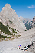 Hike the Mount Edith loop trail (8 miles) over Cory Pass, by the pinnacle of Mount Louis, in Banff National Park, Alberta, Canada. This is part of the big Canadian Rocky Mountain Parks World Heritage Site declared by UNESCO in 1984.