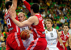 Chris Kaman of Germany between Enes Kanter of Turkey and Ersan Ilyasova of Turkey during basketball game between National basketball teams of Germany and Turkey at FIBA Europe Eurobasket Lithuania 2011, on September 9, 2011, in Siemens Arena,  Vilnius, Lithuania. Germany defeated Turkey 73-67.  (Photo by Vid Ponikvar / Sportida)