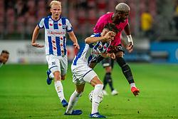 """Gyrano Kerk #7 of Utrecht, Joaquin Fernández #4 of Heerenveen in action. FC Utrecht convincingly won the practice match against sc Heerenveen. The """"Domstedelingen"""" were too strong for SC Heerenveen in Stadium Galgenwaard with 4-1<br /> on August 20, 2020 in Utrecht, Netherlands"""