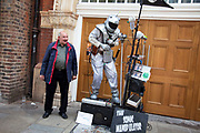 The Sonic Manipulator, a busker / street performer, performing his electronic music show to a toothless man who decided to join in the fun, much to the delight of those watching. Spitalfields in the East End of London.