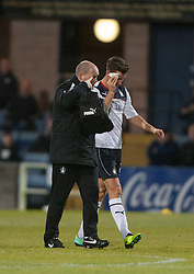 Falkirk's Kieran Duffie goes of injured with a cut eye.<br /> Dundee 1 v 1 Falkirk, Scottish Championship game at Dundee's home ground Dens Park.<br /> ©Michael Schofield.
