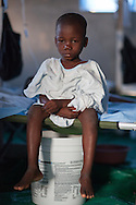 Gerard Nerulus, 6 years old recovering from cholera in a clinic run by American missionaries. The Real Hope for Haiti  Cholera Clinic in Cazel is 11 kilometers off the main road passing through Cabaret, north of Port-au-Prince is run by missionaries.