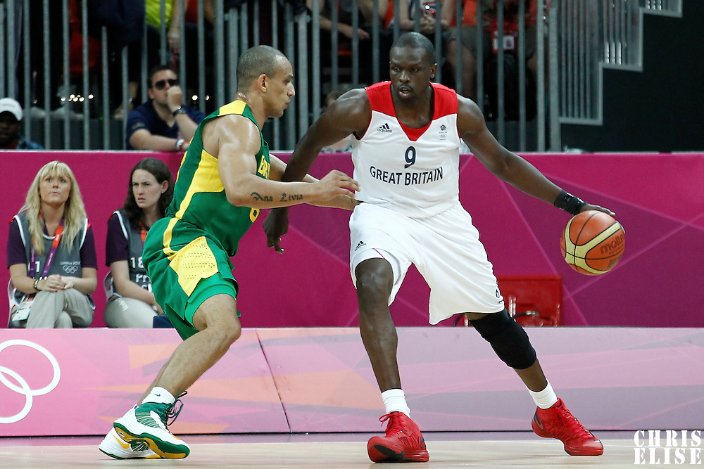 31 July 2012: Great Britain Luol Deng posts up Brazil Alex Garcia during 67-62 Team Brazil victory over Team Great Britain, during the men's basketball preliminary, at the Basketball Arena, in London, Great Britain.