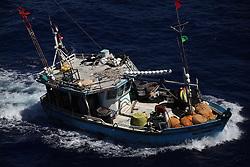 INDIAN OCEAN 24MAR13 - An unidentified Sri Lankan fishing vessel (IMUL-A-0430 CHW) with suspected shark fins on board runs at full speed in the Chagos EEZ in the Indian Ocean.<br /> <br /> <br /> <br /> The Greenpeace ship Esperanza is on patrol in the Indian ocean documenting illegal fishing vessels.<br /> <br /> <br /> <br /> jre/Photo by Jiri Rezac / Greenpeace