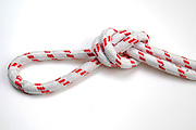 Overhead loop knot on white background simple way of forming a loop in a rope