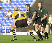 Reading Berkshire, 29/09/02<br /> London Irish vs Wasps,<br /> Exiles, Darren EDWARDS, looks for a pass as he moves past Phil GRENNING, during the, ZURICH PREMIERSHIP RUGBY match at the, Madejski Stadium,  [Mandatory Credit: Peter Spurrier/Intersport Images]