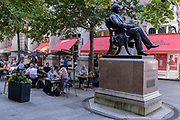 In the week that many more Londoners returned to their office workplaces after the Covid pandemic, after-hours drinkers enjoy the shade next to the statue of George Peabody during late summer temperatures in the City of London, the capitals financial district, on 8th September 2021, in London, England. George Peabody 1795 to 1869 was a philanthropist, banker and entrepreneur.