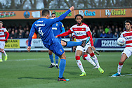 AFC Wimbledon defender Rod McDonald (4) shoots at goal during the EFL Sky Bet League 1 match between AFC Wimbledon and Doncaster Rovers at the Cherry Red Records Stadium, Kingston, England on 14 December 2019.