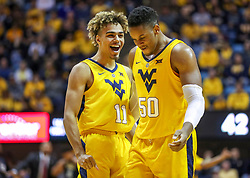 Dec 8, 2018; Morgantown, WV, USA; West Virginia Mountaineers forward Emmitt Matthews Jr. (11) reacts with West Virginia Mountaineers forward Sagaba Konate (50) during the second half against the Pittsburgh Panthers at WVU Coliseum. Mandatory Credit: Ben Queen-USA TODAY Sports