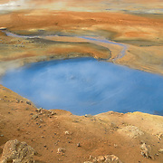Hverir is a geothermal area with at the foothill of Namafjall. Features include colorful sulphurous mud springs, steam vents, cracked mud and fumaroles. It is also called Hverarönd.