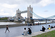 With the Coronavirus pandemic well into its fourth month people enjoy some outside time at Tower Bridge Gardens as daily life continues but on far quieter streets on 2nd July 2020 in London, United Kingdom. Coronavirus or Covid-19 is a respiratory illness that has not previously been seen in humans. While much or Europe has been placed into lockdown, the UK government has put in place more stringent rules as part of their long term strategy, and in particular social distancing.