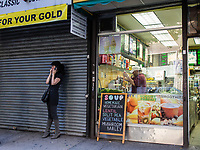 Maybe not being able to make up her mind which soup to get; East 44th street in New York City.