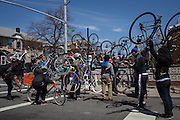 Families and friends of New Yorkers killed while bicycling on New York City streets gather at the Ghost Bike memorial for Henry Garcia, 20th Ave. and 80th St. in Brooklyn, NY, on Sunday, April 21, 2013 as they participate in the 8th Annual Ghost Bike Memorial Ride. The ride visited the 20 white-painted Ghost Bikes installed at the scene of bicyclist fatalities in five boroughs before converging at the intersection of Queens Boulevard and Jackson Avenue to dedicate a memorial to all of the cyclists who were killed in traffic crashes in 2012 whose deaths did not make the news...According to the New York City Department of Transportation, 136 pedestrians and 18 bicyclists were killed in 2012. In 2011, 134 pedestrians and 22 bicyclists were killed on New York City streets. To date, at least two bicyclists have been killed in 2013...Photograph by Andrew Hinderaker for the Ghost Bike Project.