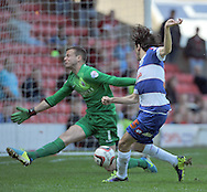 Luke Steele of Barnsley saves from Yossi Benayoun of Queens Park Rangers during the Sky Bet Championship match at Oakwell, Barnsley<br /> Picture by Graham Crowther/Focus Images Ltd +44 7763 140036<br /> 03/05/2014