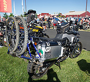 This rider carries a mountain bike on the rear of his BMW GS motorcycle.