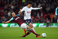 Mark Noble of West Ham United (l) tackles Dele Alli of Tottenham Hotspur (r). EFL Carabao Cup, 4th round match, Tottenham Hotspur v West Ham United at Wembley Stadium in London on Wednesday 25th October 2017.<br /> pic by Steffan Bowen, Andrew Orchard sports photography.