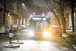 © Licensed to London News Pictures. 01/02/2019. London, UK. A bus navigates through heavy snowfall in Maida Vale, West London as large parts of the UK are deluged with snow and freeing temperatures. Photo credit: Ben Cawthra/LNP