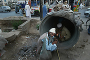 """Hooked into the sewers from Peshawar.<br /> <br /> Photographer Ton Koene took a week on heroin addicts in the sewers of Peshawar, a desolate town in Northern Pakistan. In the cracks of the world, between rats and cockroaches and under bridges and on garbage dumps, he met people, sometimes children, who have lost almost all hope.<br /> <br /> """"Give me one good reason why I should quit. I have no future, no job and income, and will never get it again. I spray me to the grave. """"So says the 11-year-old Salim Mula. Eleven years pass, petite and small, but speaking as a grown man.<br /> <br /> Salim is one of the more than 10,000 drug addicts in Peshawar, a poor northern Pakistani town with a population similar to Rotterdam. The main reason for the relatively high number of addicts in Peshawar is a lack of perspective to a job or income is hard to come by in this corner of the world. Often suffers depression to smoking hashish and the step to heroin is easily made. On every street corner to get it. As a little test I ask a young rascal to a few grams of heroin and look at my watch how long it takes. Within 40 seconds, the guy in front of me with the loot.<br /> <br /> Living in the sewers<br /> In one of the many sewers of Peshawar, I met a group of about twenty addicts. Dr. Noman a local Pakistani aid agency introduces me. The addicts greet us with a drunk alekum salam 'and stare at us with half-closed eyes. They should make every effort to focus on the visit, but also to their use: they uncoordinated stabbing a match to heat their heroin. A few meters away from them, along the asphalt, lie the graves. Luguber to see is that a hole has already been dug for the next victim. The addicts are literally using their own grave.<br /> <br /> Most addicts smoke fumes of heroin powder that they liquefy tinfoil on a piece of paper by heating it with a match. With a straw they inhale the anesthetic vapors. 'Chasing the dragon' is called in jargon users, because the liquid heroin mo"""