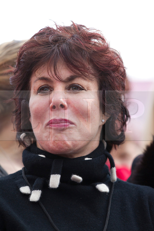 © Licensed to London News Pictures. 14/02/2013. London, UK. Comedian Ruby Wax is seen in Parliament Square, London today (14/02/13) amongst men and women remembering the 109 women killed through domestic violence in the UK as part of the 'One Billion Rising' campaign. The campaign takes its name from the statistic stating that one in three women will be raped or beaten in their lifetime (equating to one billion women). Photo credit: Matt Cetti-Roberts/LNP