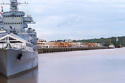 The Gironde river in Bordeaux and the war ship Le Colbert and the old harbour harbor in the background. Missile cruiser, now a tourist attraction and restaurant on the Quai des Chartrons, Garonne River