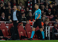 Football - 2018 / 2019 UEFA Europa League - Round of Sixteen, Second Leg: Arsenal (1) vs. Rennes (3)<br /> <br /> Referee Andris Treimanis (LAT) walks past Julien Stephan [FRA] Manager Rennes Football Club, at The Emirates.<br /> <br /> COLORSPORT/DANIEL BEARHAM