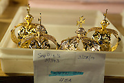 Finished crowns in a bin wait to be shipped.