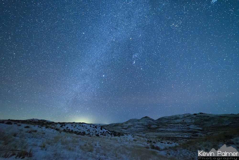 Orion and the winter milky way shines brightly above the Scoria Hills near Buffalo, Wyoming.