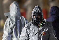 © Licensed to London News Pictures. 07/03/2018. Salisbury, UK. Police in protective suits and gas masks appear to be rehearsing search and evidence gathering techniques near Salisbury. Former Russian spy Sergei Skripal and his daughter were taken ill following a suspected poisoning in the city. The couple where found unconscious on bench in Salisbury shopping centre. Authorities now suspect a chemical nerve agent was used. Photo credit: Peter Macdiarmid/LNP