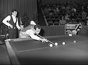 """The Benson and Hedges .Irish Masters Snooker..1984..28.03.1984..03.28.1984..28th March 1984..The championship was held at Goffs,Co Kildare. All the top names in snooker took part..Steve Davis,Jimmy White,Eddie Charlton,.Tony Knowles,Dennis Taylor,Tony Meo,.Alex Higgins,Ray Reardon,.Cliff Thorburn,Terry Griffiths,.Bill Werbeniuk and Eugene Hughes..The eventual winner was Steve Davis who beat Terry Griffiths 9 -1 in the final..Image as Tony Meo """"breaks"""" to get the game underway, Jimmy watches the proceedings."""