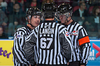 KELOWNA, CANADA - OCTOBER 4:  Kevin Crowell and Mike Langin, linesmen, stand at centre ice with Nick Swaine, referee at the Kelowna Rockets on October 4, 2013 at Prospera Place in Kelowna, British Columbia, Canada (Photo by Marissa Baecker/Shoot the Breeze) *** Local Caption ***