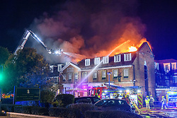 © Licensed to London News Pictures. 08/10/2021. Stokenchurch, UK. Firefighters battle a huge blaze at the Kings Hotel in Stokenchurch, Buckinghamshire. The fire started late on Friday evening (08/10/2021) with firefighters being called in from Buckinghamshire, Berkshire and Oxfordshire Fire Rescue Services. Photo credit: Peter Manning/LNP