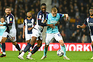 Derby County midfielder Louie Sibley (17) battles for possession  with West Bromwich Albion defender Semi Ajayi (6) during the EFL Sky Bet Championship match between West Bromwich Albion and Derby County at The Hawthorns, West Bromwich, England on 14 September 2021.